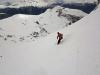 Au loin sous nos skis dans la poudreuse, les pistes de Serre Chevalier